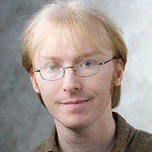 Photo of Justin Bastow, PhD