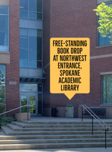 Arrow pointing to the book drop at the northwest entrance of Spokane Academic Library