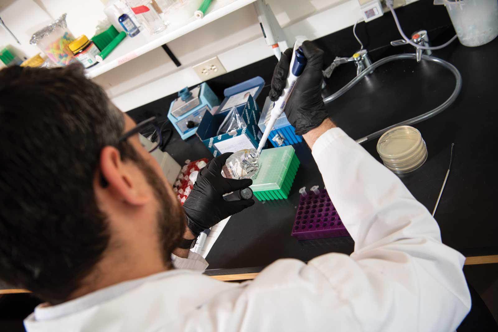 Photo: Monteiro working in the lab