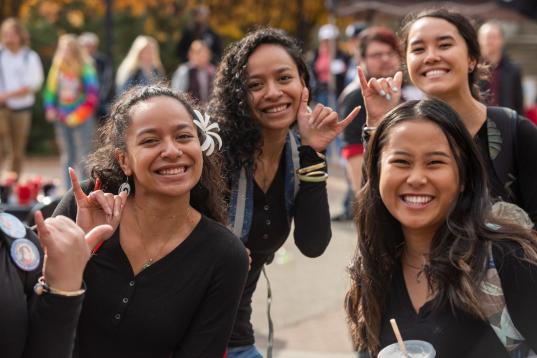 students from EWU's Hawaiian club smiling outside